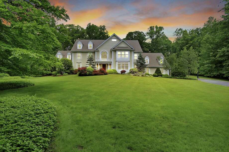 The front lawn of this attractive property serves as a welcome mat to this custom-built colonial home.
