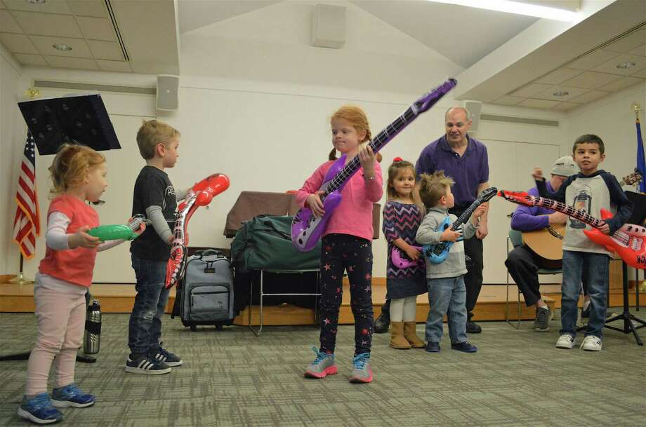 Kids jamming with air-filled guitars at the Weston Public Library's music show with Mr. Joe on Saturday, Feb. 2, 2019, in Weston, Conn. Photo: Jarret Liotta / For Hearst Connecticut Media / Westport News Freelance