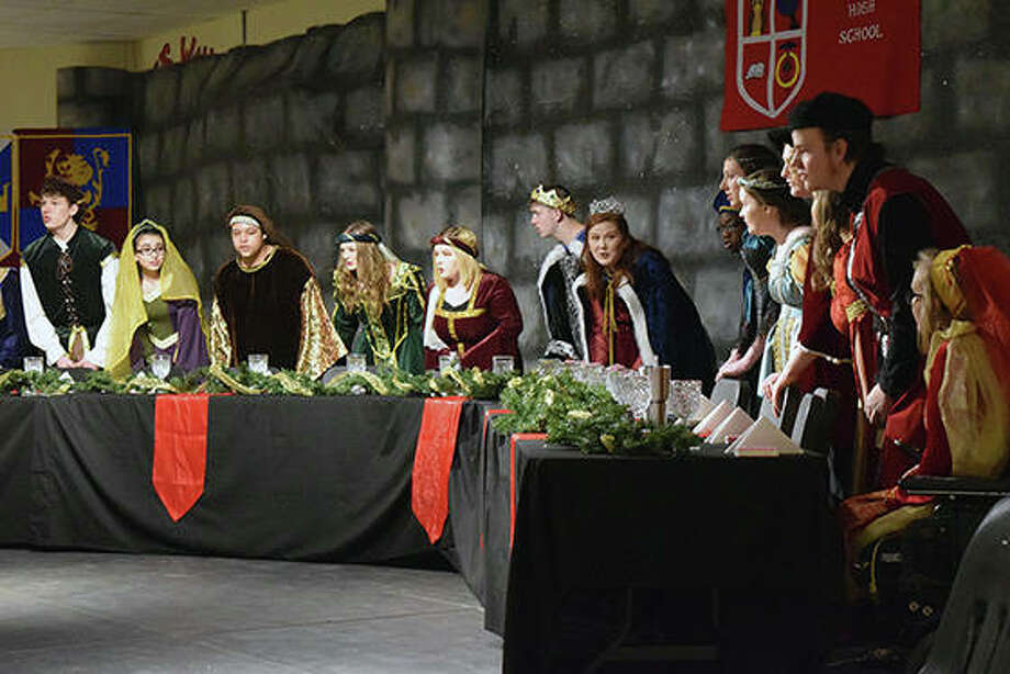 "Jacksonville High School choir members entertained the guests at Saturday evening's madrigal dinner at the school. The performance was an adaptation of ""The Wife of Bath"" from Geoffrey Chaucer's ""The Canterbury Tales."" The Queen and her court sent a knight on a quest and sang while guests were served dinner. Photo: Rosalind Essig 