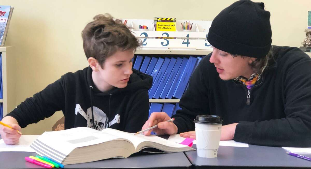 Reis Learning Center instructor Sam Hopkins, right, works with student Jessica Learson, 16, on a recent visit to the center.