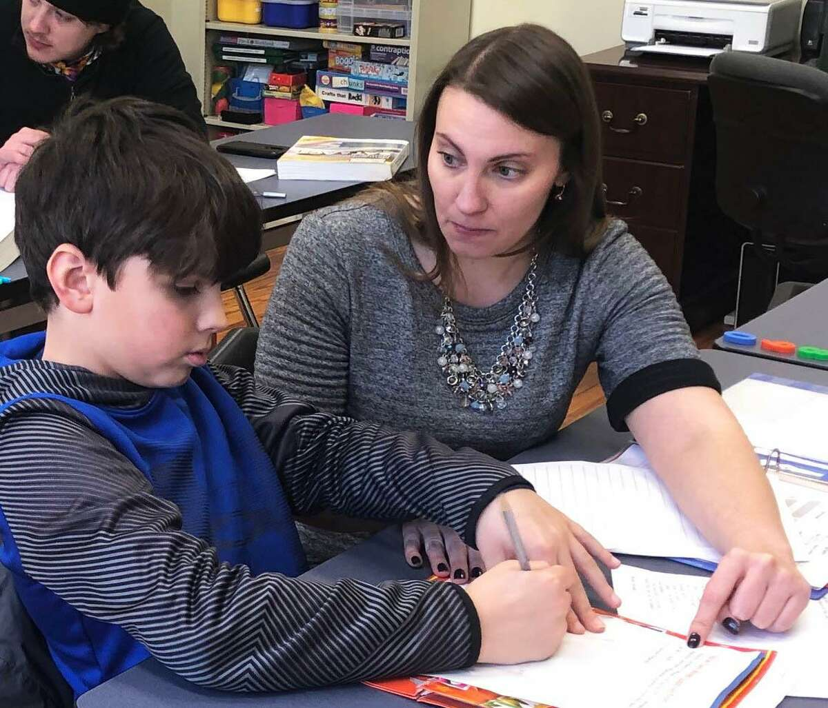 Spectrum/ Reis Learning Center, LLC in New Milford is celebrating its fifth anniversary. The center serves individuals of all ages, from kindergarten through high school, as well as adults, offering tutoring, exam prep, enrichment programs, one-time workshops and, new this year, scholarships. Above, owner Jessica Reis encourages student Caleb MacDonald, 9, to review a math problem during Caleb's recent session at the center. February 2019