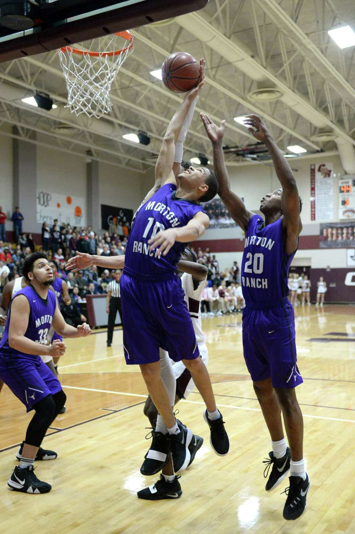 Westley Sellers (10) of Morton Ranch grabs a rebound during the second half of a high school basketball game between the Cinco Ranch Cougars and the Morton Ranch Mavericks on Jan. 29.