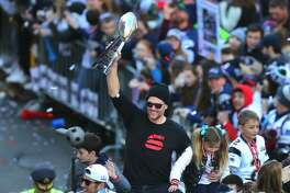 BOSTON, MA - FEBRUARY 5: New England Patriots quarterback Tom Brady holds up the Lombardi Trophy with his daughter next to him during the New England Patriots Super Bowl LIII victory parade in Boston on Feb. 5, 2019. (Photo by John Tlumacki/The Boston Globe via Getty Images)