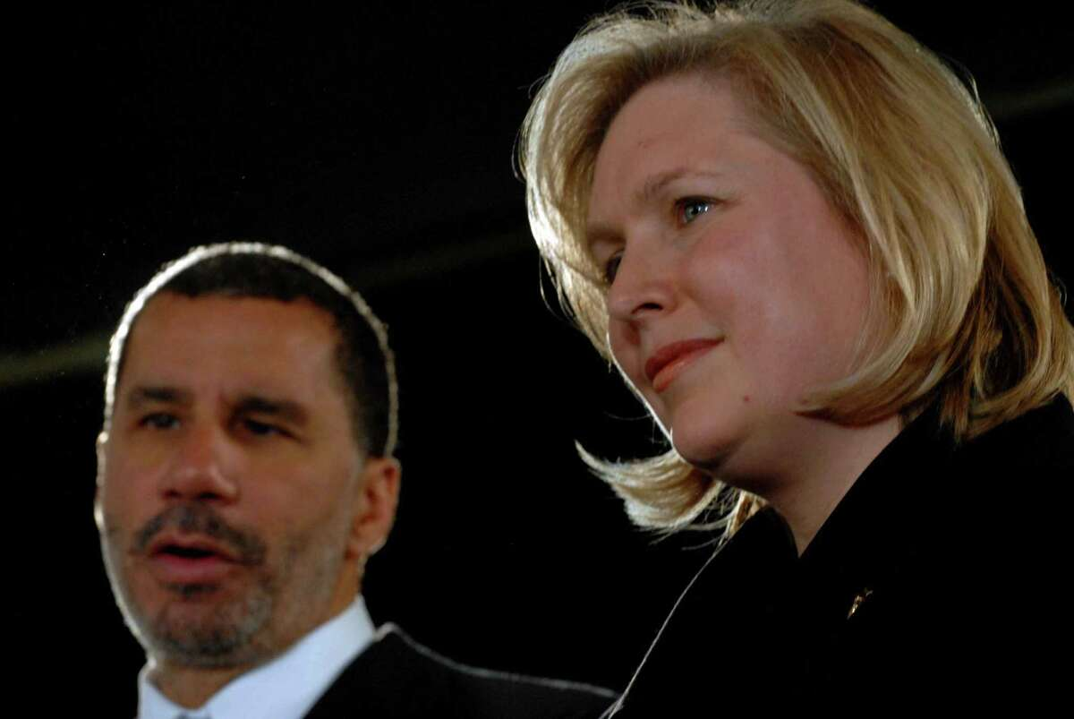 MICHAEL P. FARRELL/TIMES UNION --Albany , New York -- 01/23/2009 -- Congresswomen Kirsten Gillibrand and newly appointed U.S. Senator , right, and Gov. David Paterson take questions from the media following her appointment ceremony by Gov. David Patterson at the Capitol.