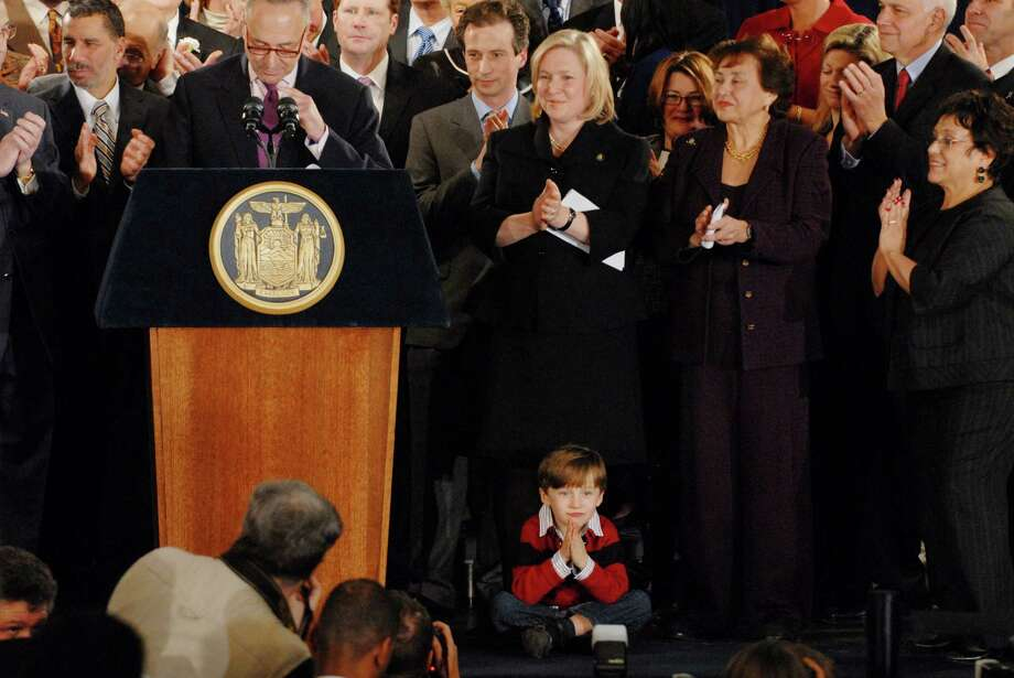 U.S. Rep. Kirsten Gillibrand with her son Theodore, who crawled onstage, as U.S. Sen. Chuck Shumer speaks during a news conference announcing her as New York Gov. David A. Paterson's choice to fill the vacant U.S. Senate seat for New York on January 23, 2009 in Albany, New York. Caroline Kennedy withdrew her name from consideration a day before the announcement of the Governor's decision for filling the seat which was left vacant by the new Secretary of State Hillary Rodham Clinton. (Michael P. Farrell / Times Union) / 00002170A