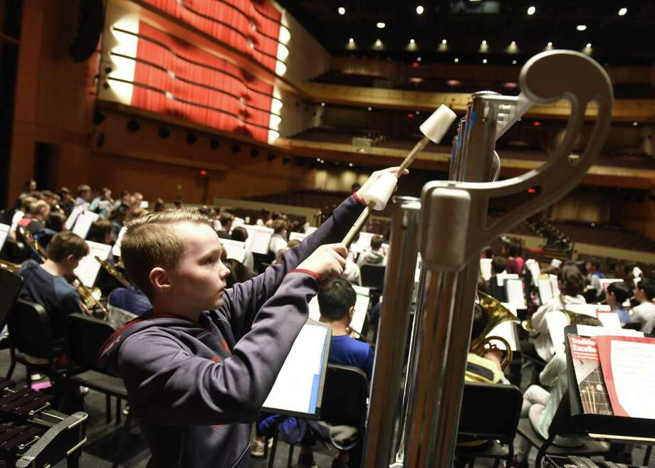 Thomas Powers plays the chimes with the Greenwich Public Schools Honors Band during rehearsal in the Performing Arts Center at Greenwich High School in Greenwich, Conn. Monday, Feb. 4, 2019. 108 fifth- and sixth-graders will take the stage to perform on Feb. 6. Photo: Tyler Sizemore / Hearst Connecticut Media / Greenwich Time