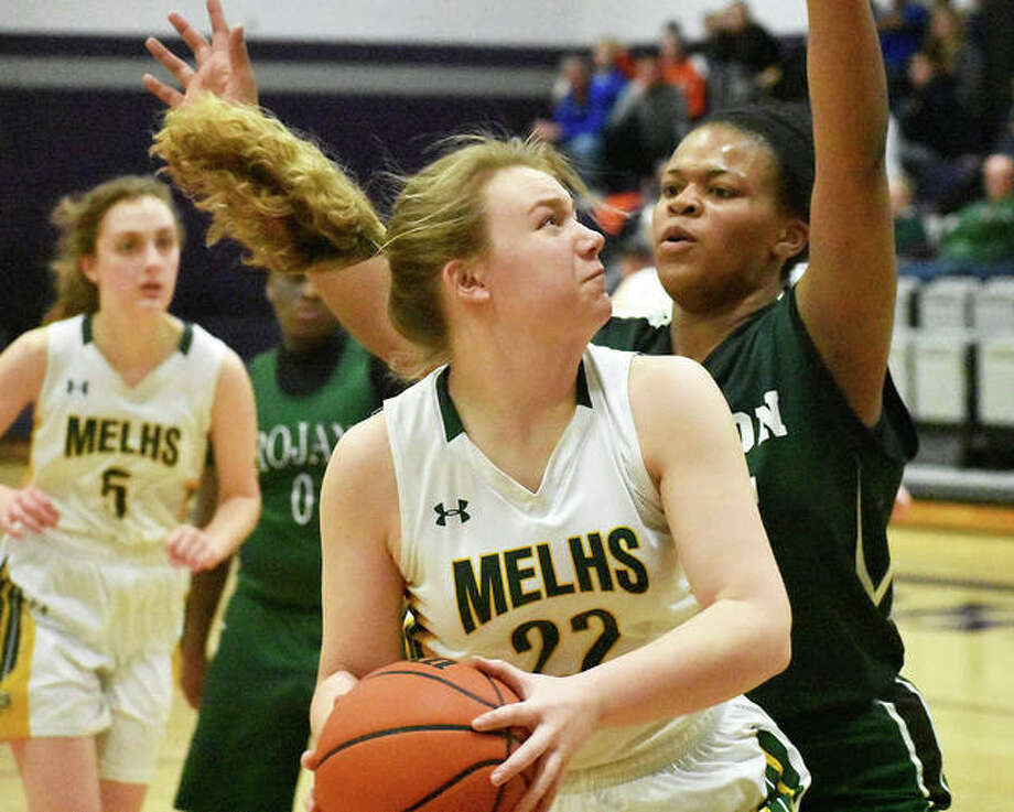 Metro-East Lutheran's Jennifer Leitner dribbles to the basket during first-half action against Madison on Monday in a Class 1A Lebanon Regional game.