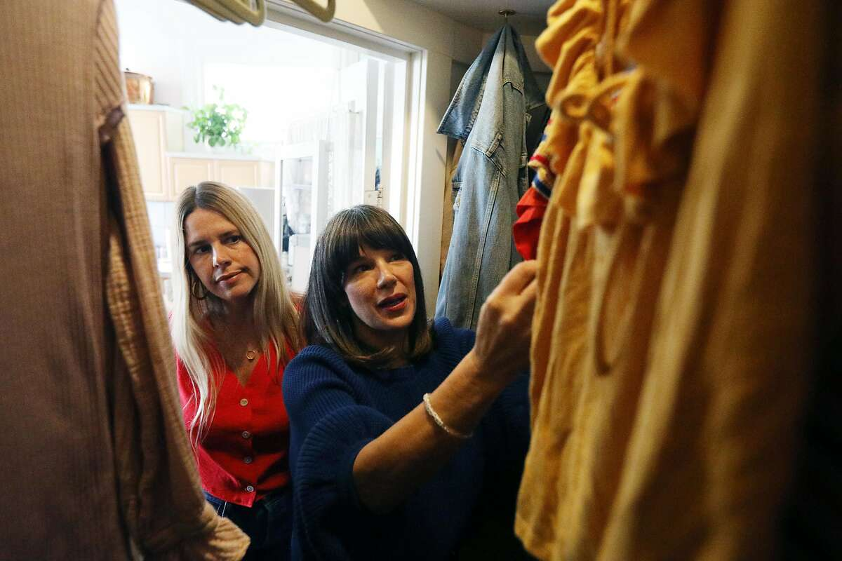 Mira Pickett (right), owner Mira Mira The Edit, and client Joanna Riedl (left) discuss items in Riedl's closet during a a closet and style consultation on Monday, February 4, 2019 in San Francisco, Calif.