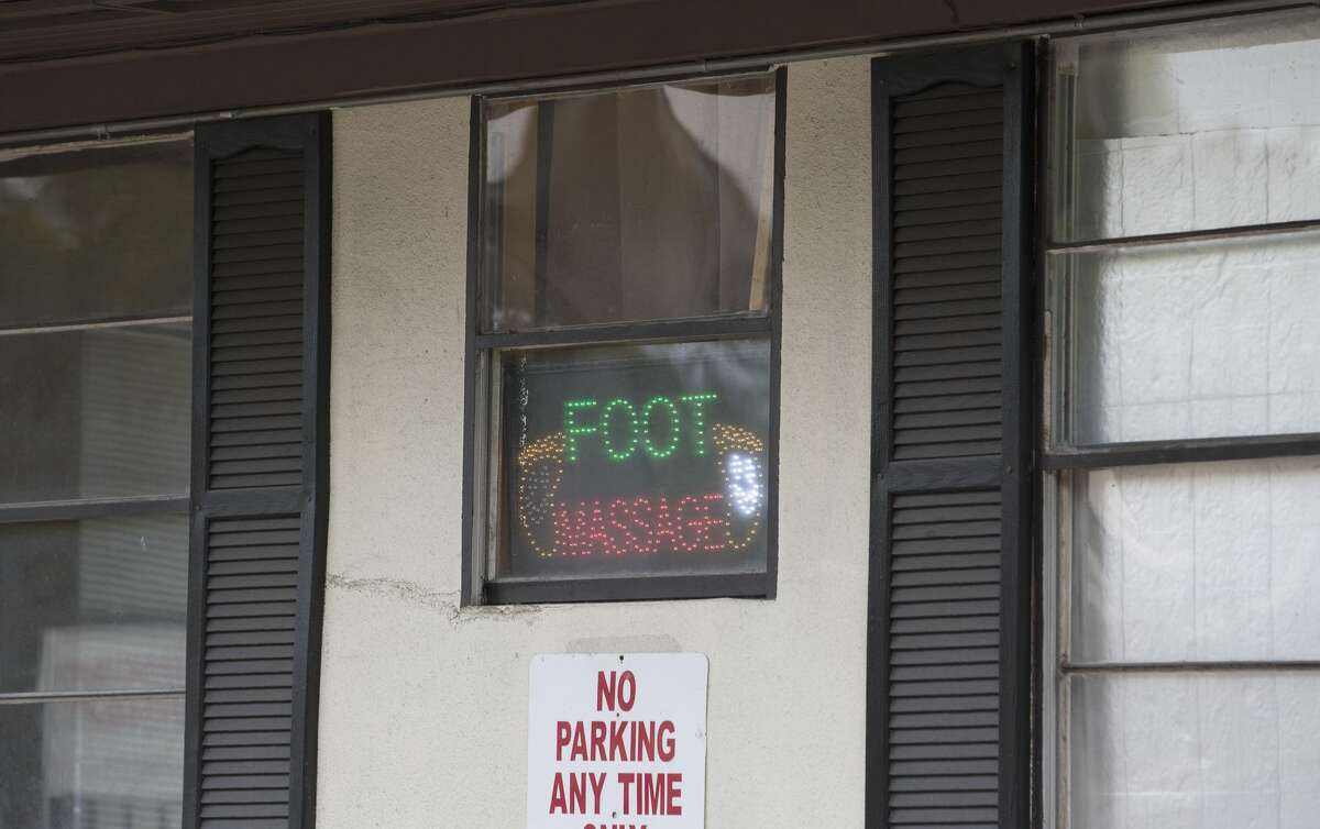 A foot massage sign shows this massage parlor on Richmond Avenue remains open after being sued by Harris County for being the front for prostitution Friday, Nov. 11, 2016, in Houston. (Yi-Chin Lee / Houston Chronicle )