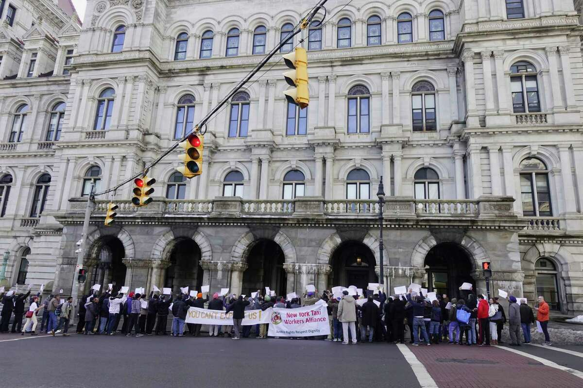 Professional drivers from New York City protest outside the Capitol on Tuesday, Feb. 5, 2019, in Albany, N.Y. The drivers came to Albany to denounce the congestion surcharge that went into effect on Saturday for taxi and for-hire-vehicle rides in Manhattan's central business district. (Paul Buckowski/Times Union)