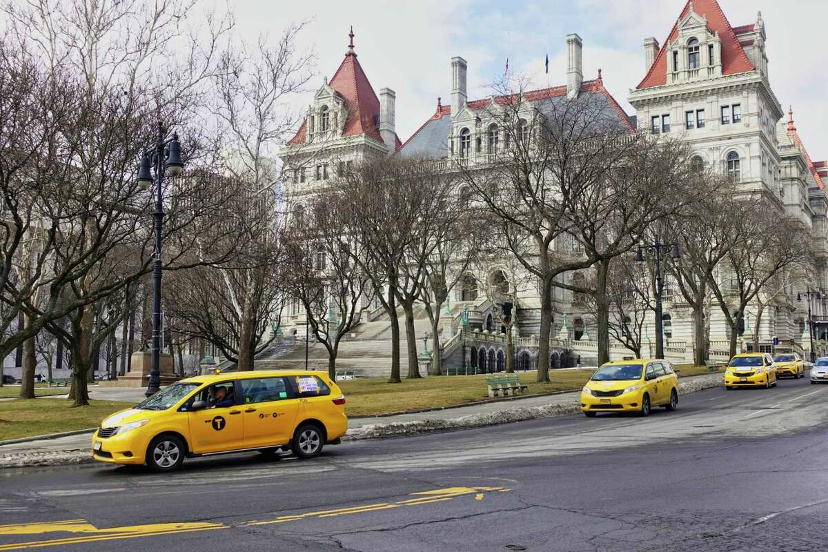 Professional drivers from New York City drive their vehicles around the Capitol as they take part in a protest on Tuesday, Feb. 5, 2019, in Albany, N.Y. The drivers came to Albany to denounce the congestion surcharge that went into effect on Saturday for taxi and for-hire-vehicle rides in Manhattan's central business district. (Paul Buckowski/Times Union)