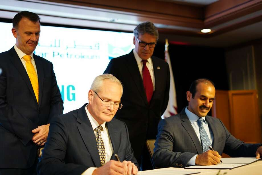 Executives with ExxonMobil and Qatar Petroleum sign a deal making a final investment decision on the $10 billion Golden Pass LNG export terminal near Port Arthur. A joint venture between three energy service companies from Houston, San Antonio and Japan has landed a contract to build the plant. Photo: U.S. Department Of Energy