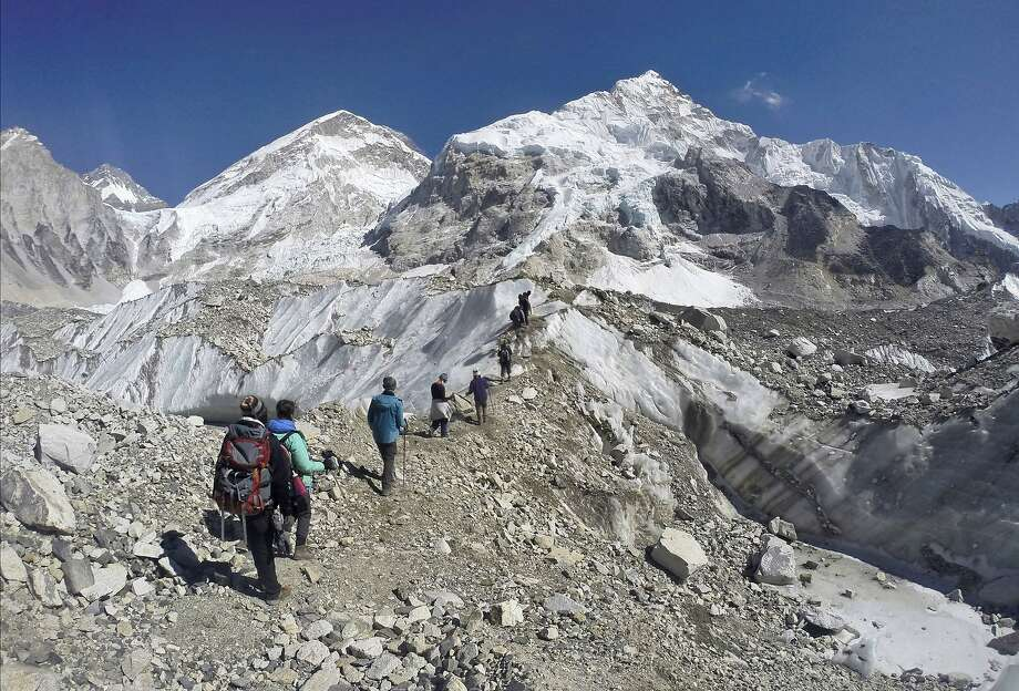 Trekkers pass through a glacier in 2016 on Mount Everest. Global warming is on track to transform Himalayan glaciers into bare rocks in less than a century. Photo: Tashi Sherpa / Associated Press 2016