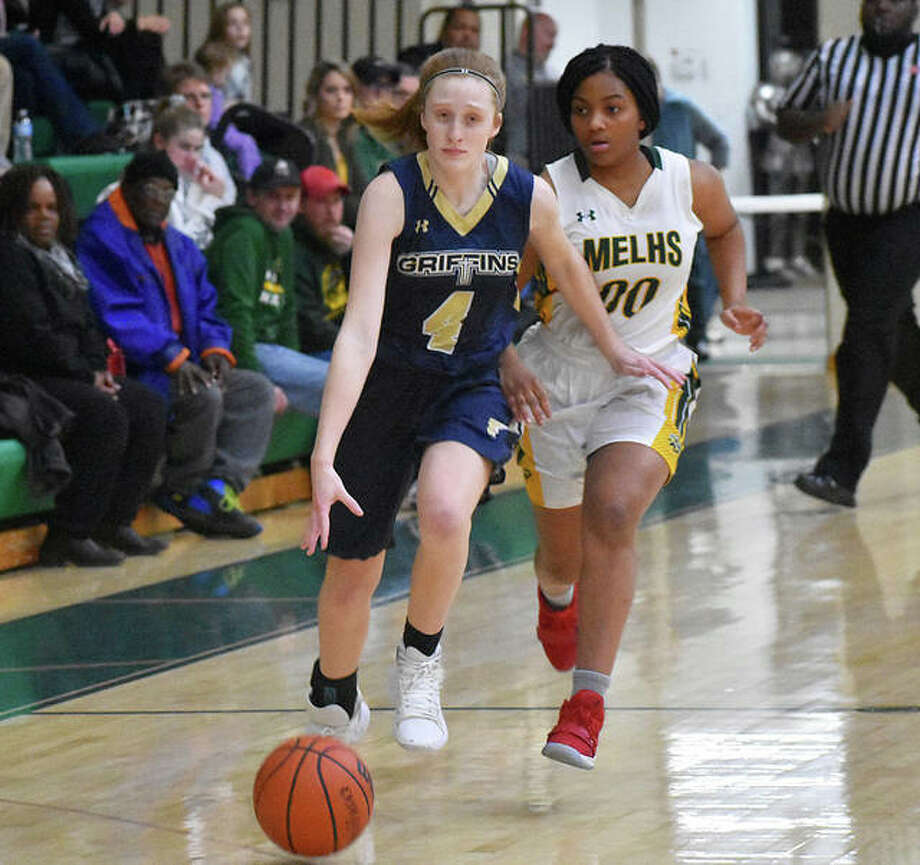 FMCHS guard Anna McKee dribbles down the court with MELHS guard Destiny Williams chasing after her during a regular-season game. Photo: Matt Kamp/Intelligencer