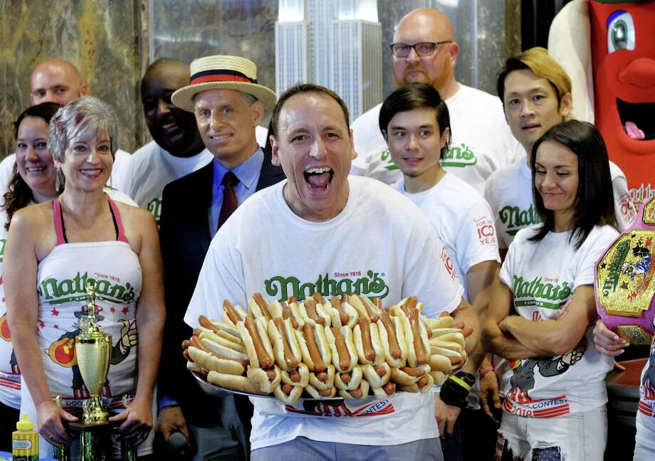 Joey Chestnut is the men's world record holder with 72 hot dogs eaten during Nathan's Famous International Fourth of July Hot Dog Eating Contest. He set the mark in 2018. Photo: Evan Agostini /Associated Press / 2018 Invision