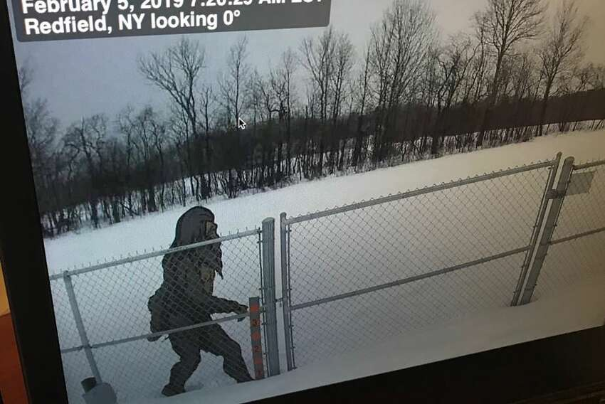 Someone placed a Yeti, or abominable snowman cutout in front of one remote weather station.