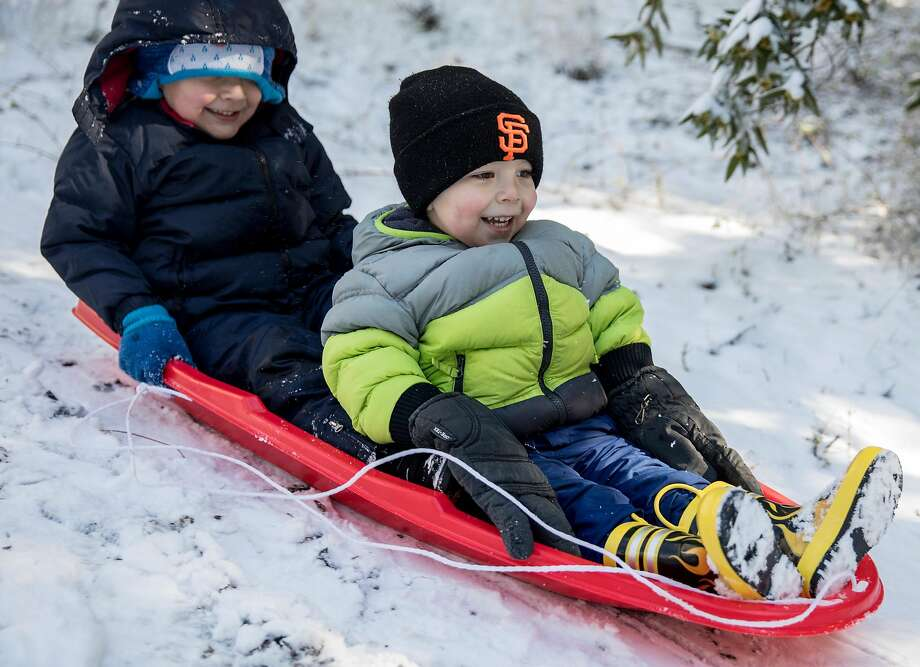 Adrian Orput, 4, of Castro Valley (left) and Justin Vance Jr., 2, of Danville sled down a hill near Juniper Campground after overnight snow blanketed the summit of Mount Diablo in Walnut Creek, Calif. Tuesday, Feb. 5, 2019. Photo: Jessica Christian / The Chronicle