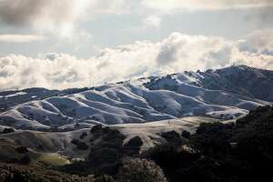 Snow covers the Morgan Territory hills in Livermore, Calif. as seen from Mount Diablo in Walnut Creek, Calif. Tuesday, Feb. 5, 2019.