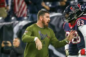 HOUSTON, TX - NOVEMBER 26:  Houston Texans tight end coach Tim Kelly warms up players during the football game between the Tennessee Titans and Houston Texans on November 26, 2018 at NRG Stadium in Houston, Texas.  (Photo by Leslie Plaza Johnson/Icon Sportswire via Getty Images)