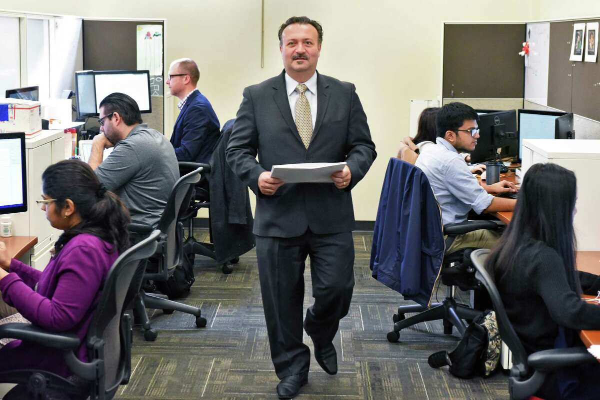 CEO Antonio Civitella, center, in Transfinder's technology room Tuesday Feb. 28, 2017 in Schenectady, NY. (John Carl D'Annibale / Times Union)