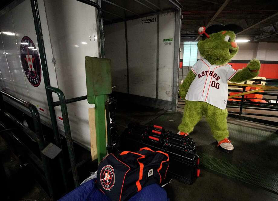 Houston Astros mascot Orbit playful directs forklift traffic as workers load Houston Astros equipment into a truck at the Minute Maid Park that is bound for the team's spring training at Fitteam Ballpark of the Palm Beaches Tuesday, Feb. 5, 2019, in Houston. Photo: Melissa Phillip, Staff Photographer / © 2019 Houston Chronicle