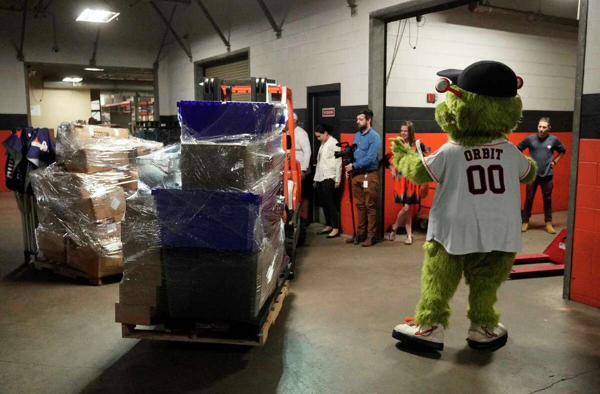 Houston Astros mascot Orbit playful directs forklift traffic as workers load Houston Astros equipment into a truck at the Minute Maid Park that is bound for the team's spring training at FITTEAM Ballpark of the Palm Beaches Tuesday, Feb. 5, 2019, in Houston.
