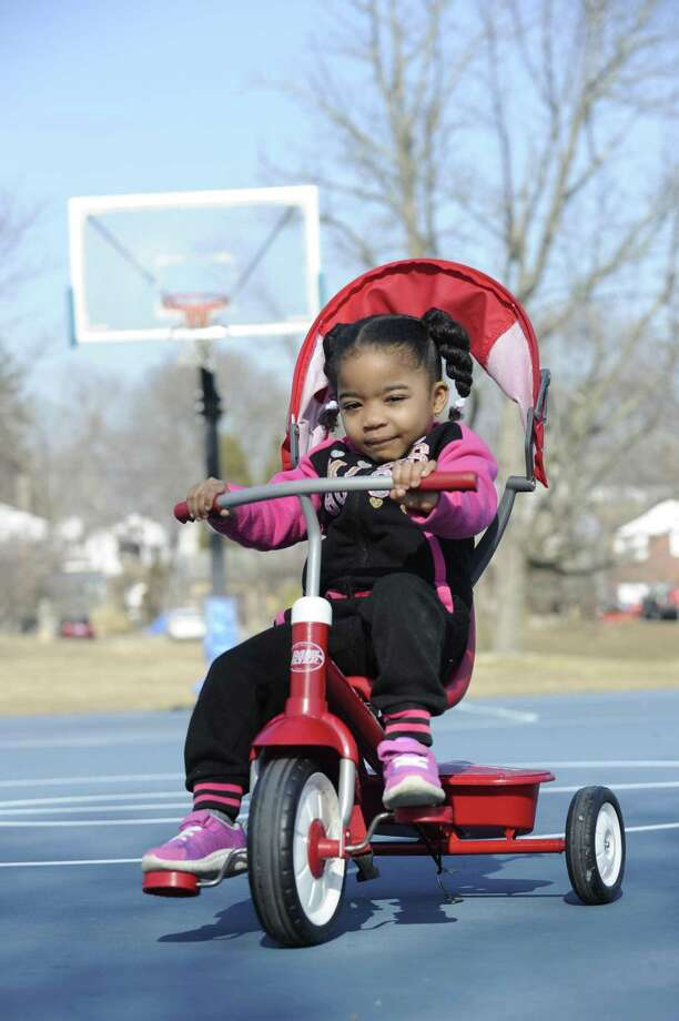 Mariah Williams, 3, of Stamford takes advantage of the warm weather to ride her tri-cycle at the basketball courts at Cove Island Park on Tuesday, Feb. 5, 2019 in Stamford, Connecticut. Photo: Matthew Brown / Hearst Connecticut Media / Stamford Advocate