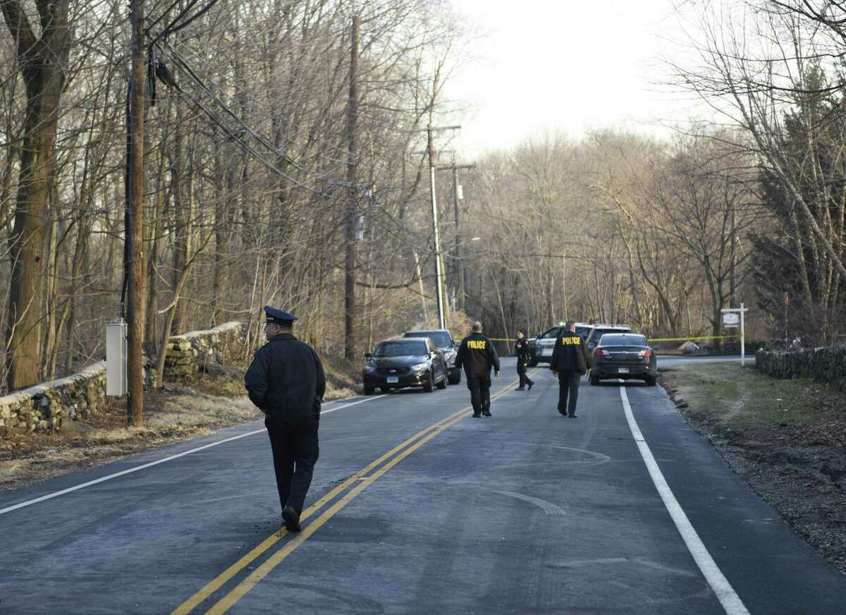 Greenwich Police block traffic after a body was found in the Glenville section of Greenwich, Conn. the morning of Tuesday, Feb. 5, 2019. According to police, a town worker found the bound body of a female between the ages of 18 and 30 just off of Glenville Road near the intersection with Stillman Lane.