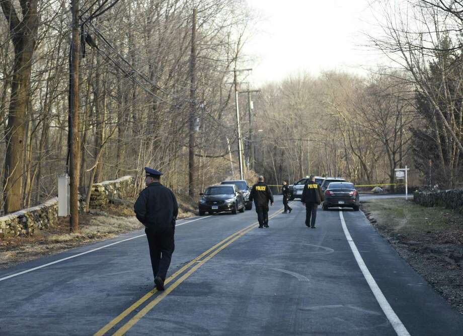 Greenwich Police block traffic after a body was found in the Glenville section of Greenwich, Conn. the morning of Tuesday, Feb. 5, 2019. According to police, a town worker found the bound body of a female between the ages of 18 and 30 just off of Glenville Road near the intersection with Stillman Lane. Photo: Tyler Sizemore / Hearst Connecticut Media / Greenwich Time