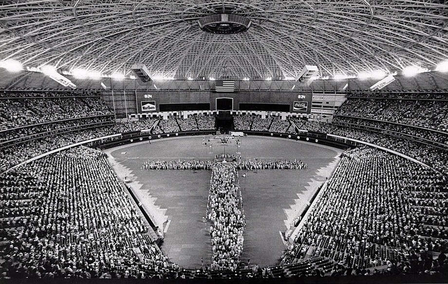 """In this 1979 file photo, attendees of the Southern Baptist Convention's annual meeting, held that year in Houston, form a """"human cross"""" at the Astrodome. Photo: John Van Beekum"""