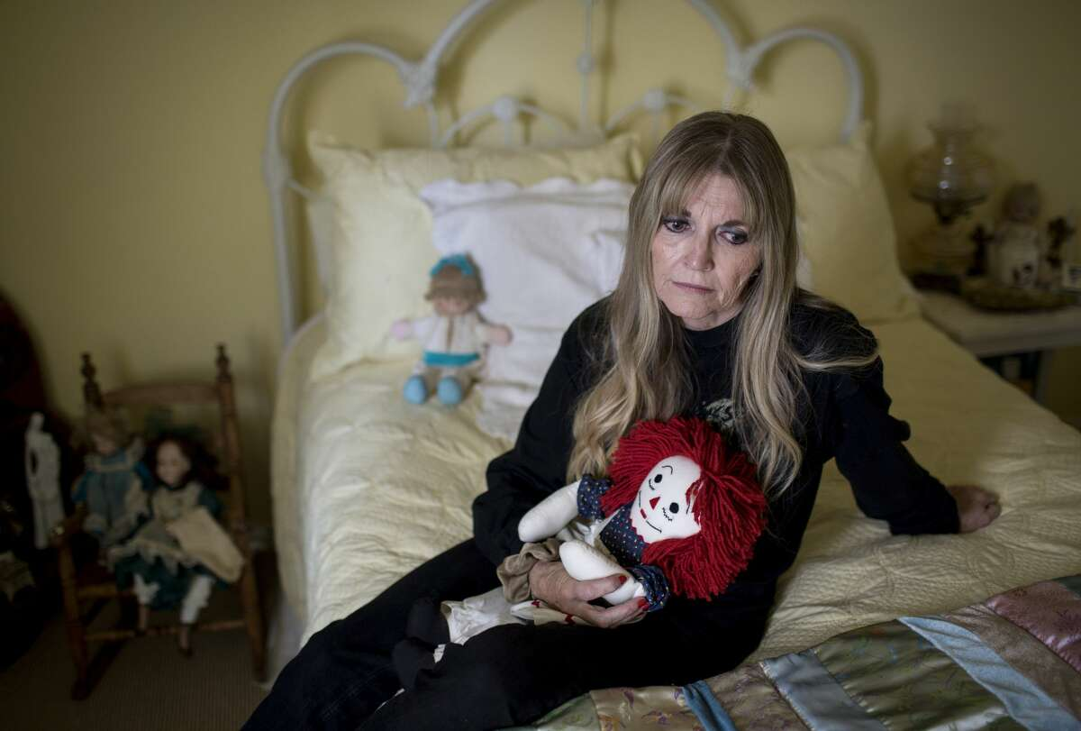 Gwen Casados sits in her daughter's room in Houston. Her daughter, Heather Schneider, was sexually abused inside Second Baptist Church in Houston in 1994 and later died of a drug overdose.