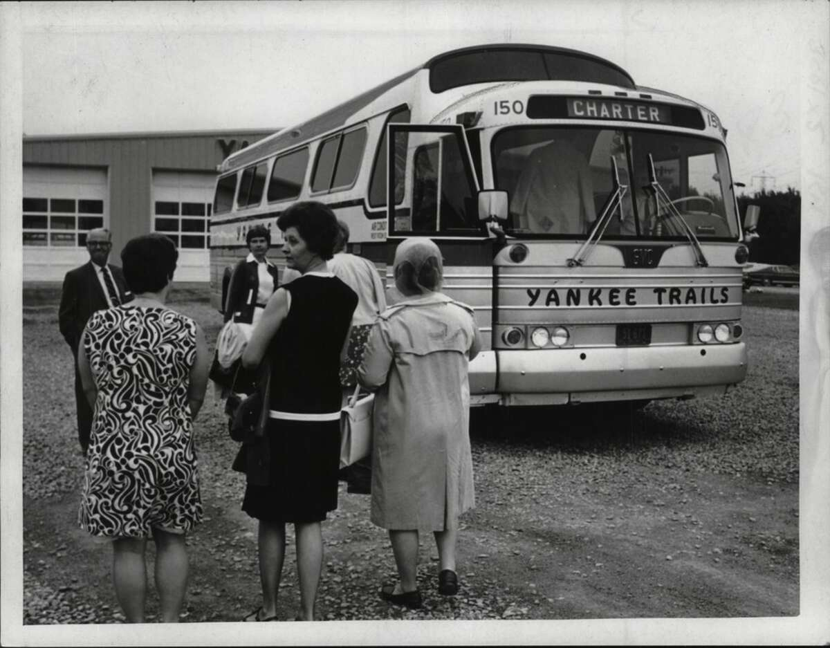 Passengers board a Yankee Trails charter bus in New York in July of 1970.
