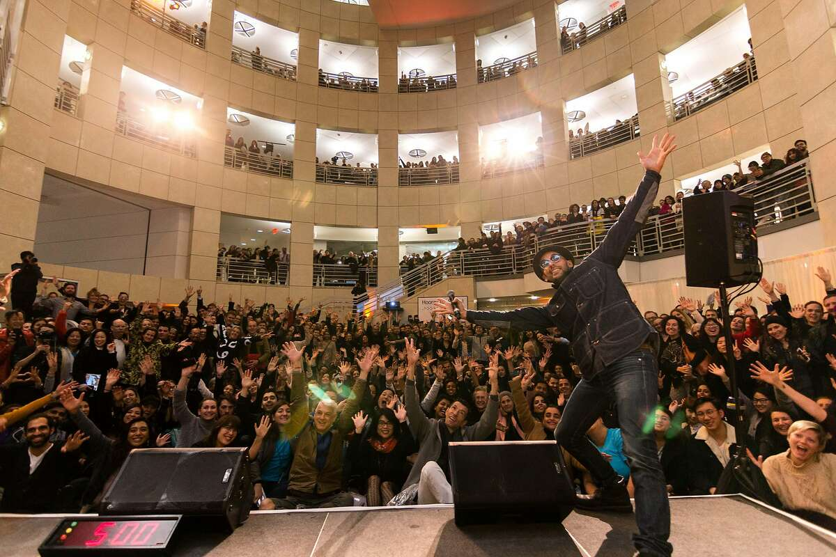 The artist JR with some of the 6,000 people who attended Night of Ideas at the Main Library.