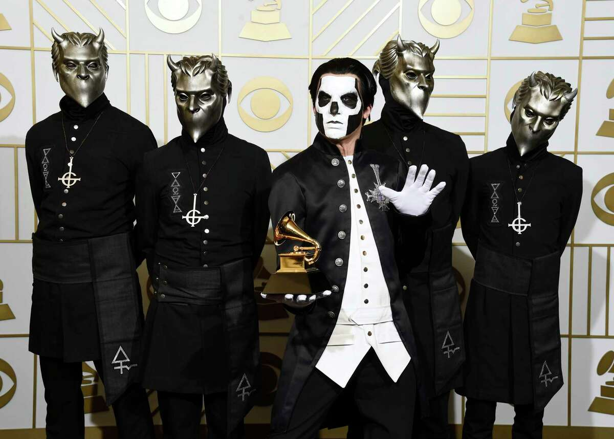 """FILE - In this Feb. 15, 2016 file photo, Ghost poses in the press room with the award for best metal performance for """"Cirice"""" at the 58th annual Grammy Awards in Los Angeles. Ghost is up for best rock album and best rock song at the Grammy Awards on Sunday. (Photo by Chris Pizzello/Invision/AP, File)"""