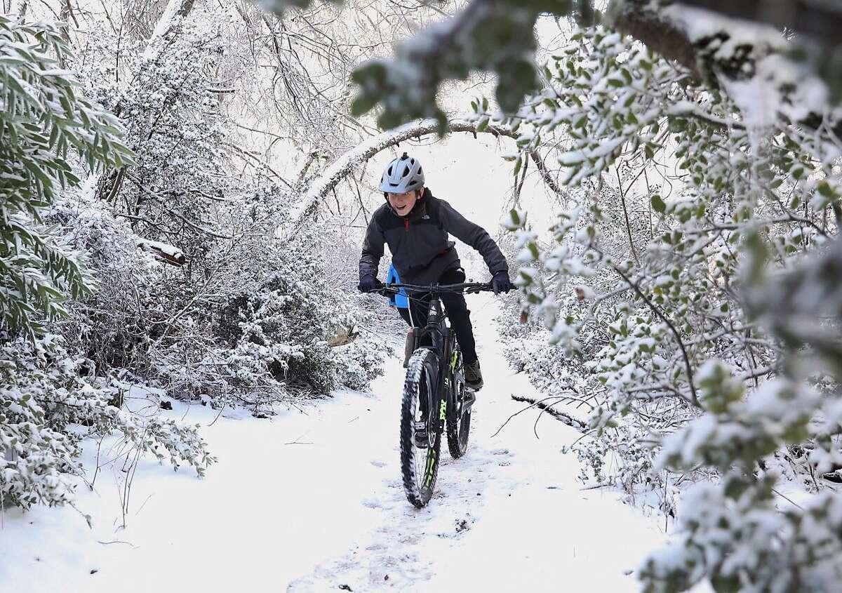 Matt Startsev, 13, of Danville rides a mountain bike up a trail through blanket of snow near the summit of Mount Diablo near Walnut Creek, Calif. Tuesday, February 5, 2019.