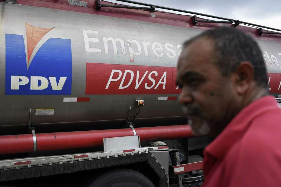 An employee stands in front of a fuel truck at a Petroleos de Venezuela SA (PDVSA) gas station in Caracas, Venezuela, on Tuesday, Jan. 29, 2019. President Donald Trump sanctioned Venezuela's state-owned oil company PDVSA and its central bank on Monday, the latest U.S. move intended to raise pressure on the regime of President Nicolas Maduro. Photographer: Carlos Becerra/Bloomberg Photo: Carlos Becerra / Bloomberg / © 2019 Bloomberg Finance LP