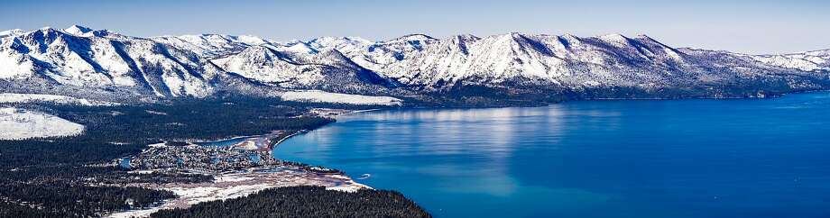 Aerial view of Lake Tahoe on a sunny winter day in California. Sierra mountains covered in snow are visible in the background. Photo: Andrei Stanescu / iStock / Getty Images Plus / Getty Images/iStockphoto