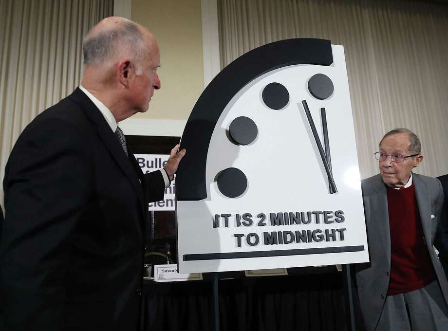 Former California Gov. Jerry Brown and former U.S. Secretary of Defense William Perry last month unveil the Doomsday Clock from the Bulletin of the Atomic Scientists, which cites climate change along with nuclear threats. It's time to listen to the experts. Photo: Mark Wilson /Getty Images / 2019 Getty Images