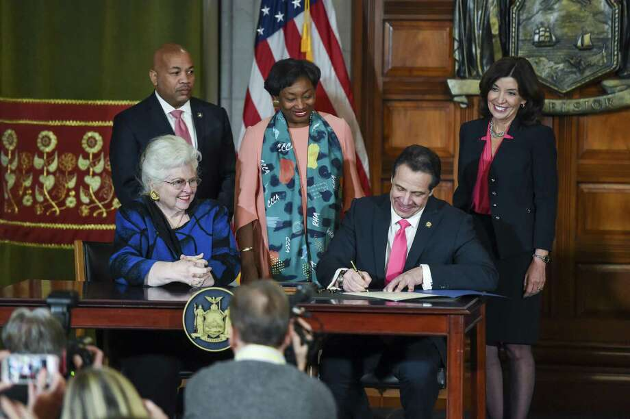 Gov. Andrew Cuomo signs the Reproductive Health Act Jan. 22, expanding abortion rights, at the State Capitol in Albany, N.Y. Jan. 22, 2019. The measure would allow later term abortion than even now. Photo: CINDY SCHULTZ /NYT / NYTNS