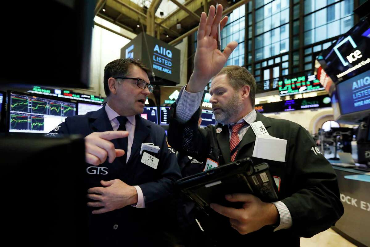 Specialist David Haubner, left, and trader Thomas McCauley work on the floor of the New York Stock Exchange, Tuesday, Feb. 5, 2019. Stocks are opening higher on Wall Street as investors welcomed some strong earnings reports from U.S. companies. (AP Photo/Richard Drew)