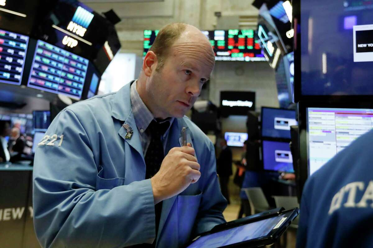 Trader Peter Mancuso works on the floor of the New York Stock Exchange, Tuesday, Feb. 5, 2019. Stocks are opening higher on Wall Street as investors welcomed some strong earnings reports from U.S. companies. (AP Photo/Richard Drew)