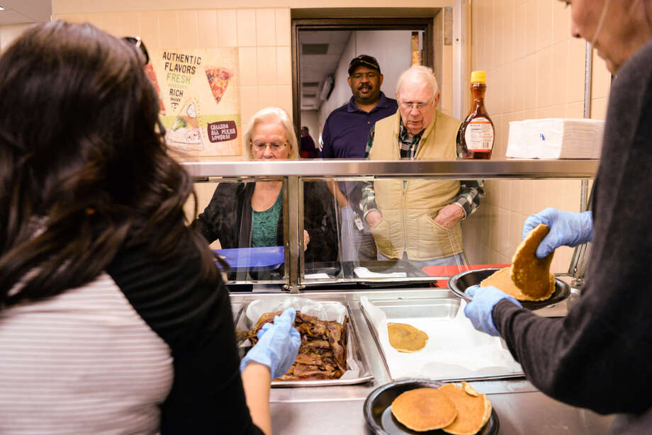 Lions Club members Tonya Keesee (right) and Veronica McClanahan (left) serve pancakes, bacon and sausage during the Plainview Lions Club Annual Pancake Supper at the Plainview High School Cafeteria Friday, Feb. 1, 2019. Photo: Abbie Burnett/For The Herald