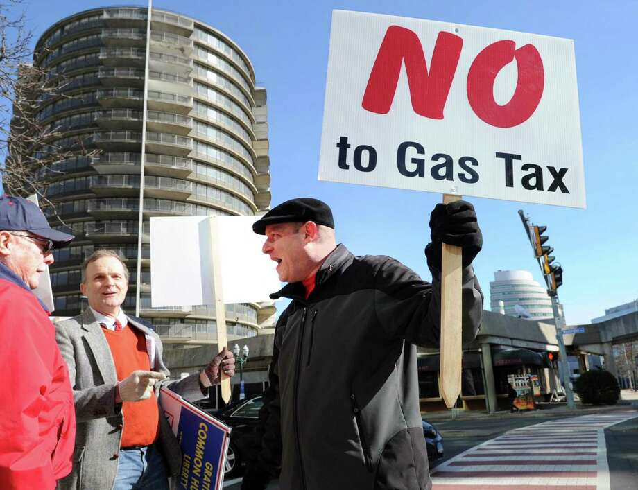"""""""No to Gas Tax,"""" reads the sign held by a Stamford trucking company owner Patrick Sasser during the protest against tolls, a new gas tax and tire tax, held in front of the Stamford Goverment Center, Stamford, Conn., Saturday, Feb. 17, 2018. Sasser said about the proposed taxes """"these taxes would really hurt small businesses. We are already taxed to death."""" Roughly 75 people attended the protest that was accompanied by a caravan of trucks circling the center honking their horns in support of the protestors. Gov. Dannel P. Malloy wants legislators to pass measures including electronic tolls, an increase in state gasoline taxes and a new tax on the sale of tires, to pay for Connecticut's transportation system that he says is facing a serious fuding crisis. Photo: Bob Luckey Jr. / Hearst Connecticut Media / Greenwich Time"""