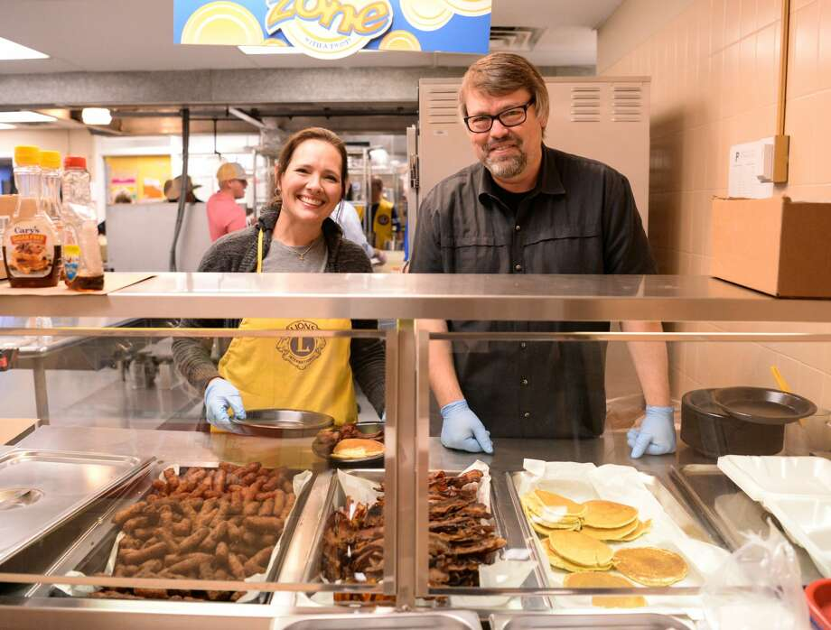 Lions Club members Ashley Mayberry (left) and Tim Crosswhite (right) serve pancakes, bacon and sausage during the Plainview Lions Club Annual Pancake Supper at the Plainview High School Cafeteria Friday, Feb. 1, 2019. [Abbie Burnett/For the Plainview Herald] Photo: Abbie Burnett/For The Herald
