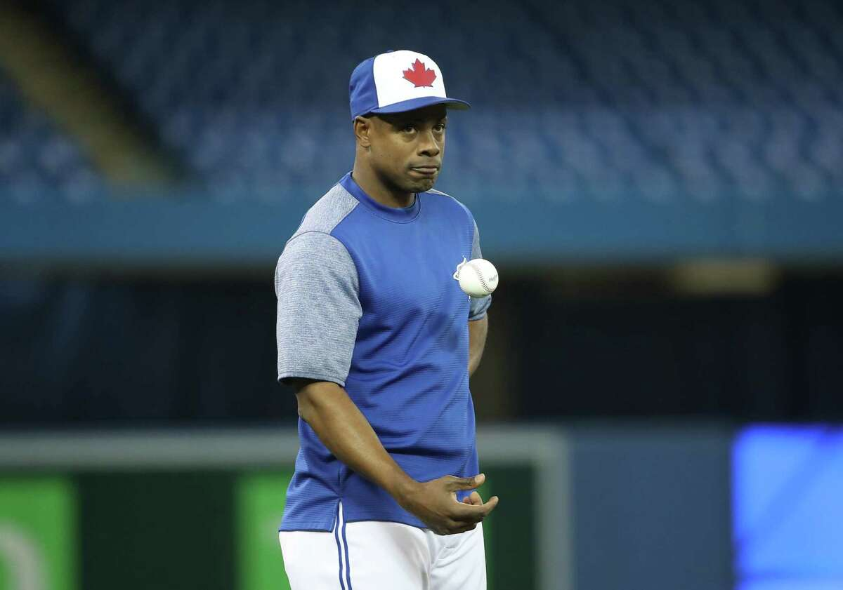TORONTO, ON - MARCH 29: Curtis Granderson #18 of the Toronto Blue Jays warms up on Opening Day before the start of MLB game action against the New York Yankees on Opening Day at Rogers Centre on March 29, 2018 in Toronto, Canada. (Photo by Tom Szczerbowski/Getty Images)