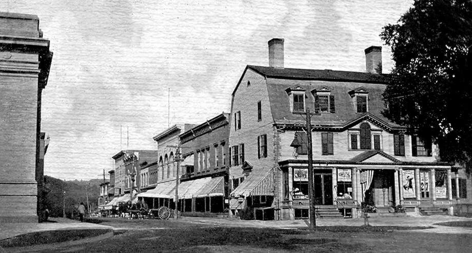 "This postcard of the Main Street and Bank Street intersection in New Milford, circa 1906, was mailed Nov. 5, 1906, to Miss Mattie Ruffelo, #36 Liberty St., Bridgeport, Conn. from ""G.O.,"" who wrote ""at this city today, 11-5-06."" The postcard was published by Frank E. Soule. If you have a ""Way Back When"" photograph, contact Deborah Rose at drose@newstimes.com or 860-355-7324. Photo: Courtesy Of Marcy DeCosa / The News-Times Contributed"