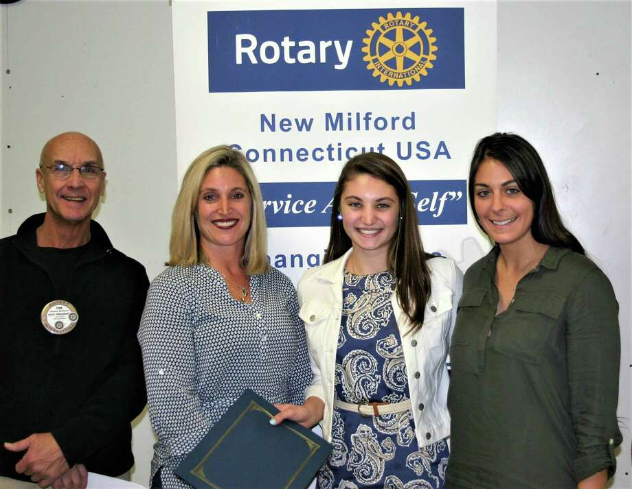 The Rotary Club of New Milford recently presented its November Student of the Month Award to New Milford High School senior Mackenzie Antonucci. Mackenzie has been a part of the All-Conference Academic Team for three years, is a member of the National Honor Society, the Spanish Honor Society and captain of the NMHS volleyball team. She volunteers with the Girls in the Groove running club for students in third through fifth grade and at the Maureen Haas Cross Country meet in the school system, and works at All Aboard Pizza. Mackenzie will major in physical education/management with the goal of becoming a physical education teacher. Mackenzie, second from right, is shown above with, from left to right, Rotarian Tom McSherry, Mackenzie's mother Julie and NMHS phys ed teacher Victoria Murray. Photo: Courtesy Of Rotary Club Of New Milford / The News-Times Contributed