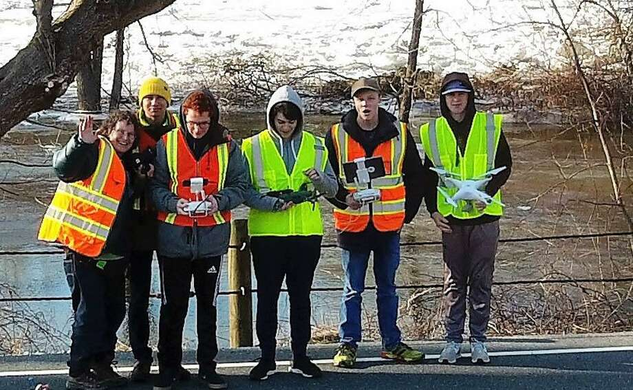 Marvelwood School Science Department Chairman Laurie Doss, left, is shown with Marvelwood School students, from left to right, Oliver Sanchez, Edward Duffy, Allen Nash, George Ryan and Chris Scherer, who recently volunteered their time to use their unmanned aerial vehicle skills to help the Kent Volunteer Fire Department and the National Oceanic and Atmospheric Administration monitor the ice and flooding on the Housatonic River. Photo: Courtesy Of Marvelwood School / The News-Times Contributed