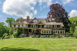 """A Washington house designed by architect Ehrick Rossiter has been listed with Klemm Real Estate for $6.2 million. Rock Gate, named for the dramatic outcropping of glacially carved stone encircled by the driveway is an important piece of Washington's history and a Connecticut Preservation Award winning example of Rossiter's design legacy. The house is on the Washington Green, along a quiet dead-end road, is situated on 3.13 acres abutting a land trust. Built in 1885 as a Gilded Age """"summer cottage"""" for General Lucious Barbour, a wealthy Hartford industrialist, art collector, and Connecticut State legislator, Rock Gate is considered Rossiter's best domestic work in the Queen Anne style and his finest home design in the town of Washington, which boasts 15 Rossiter homes. For more information, contact Carol Klemm or Peter Klemm at 917-864-4940."""