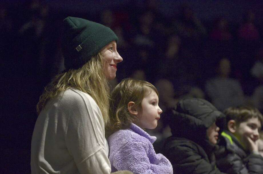 Kimberly Wallengren, of New Preston, holds her daughter Bellamy, 2, on her lap as they watch Peter Rabbit at the 13th annual puppetry festival at the Washington Montessori School in New Preston. Photo: H John Voorhees III / Hearst Connecticut Media / The News-Times